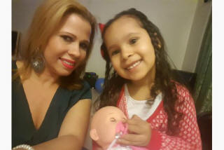 Damaris Bueno, with her daughter Mia, 4, welcomes plans to allow single parents on social assistance to keep more of their child support income.